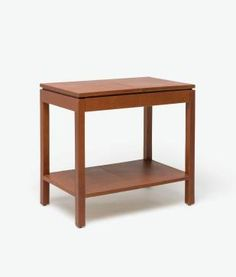 Large Chastain Leather Side Table Thin Legs andSingle Shallow Drawer Available in Tobacco or Cream Leather  Made from natural cowhide leather that has multiple natural variations in color and texture with imperfection throughout the natural grain.