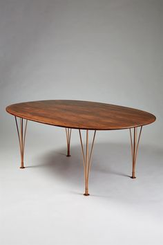 Bruno Mathsson and Piet Hein; Rosewood and Copper 'Superelipse' Dining Table for Karl Mathsson, 1964.