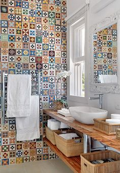 Multi colored wall bathroom tiles with wooden rack