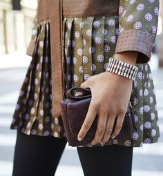 Must-have fall accessories: a small leather clutch, and this sparkly statement bracelet. Style these with this silk drop-waist dress for an extra polished look | Banana Republic