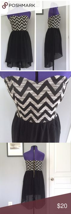 Chevron Hi Lo Dress • Tini Lili Black & Gray Dress Super cute high-low dress from Tini Lili with a fitted Chevron print bodice and a flowy black contrast. Strapless dress with a sweetheart neckline and exposed gold back zipper.   Tini Lili  Size Medium Cotton & Polyester blend Fully lined High Low  Gray • Grey • Black  ⭐️LIKE NEW!⭐️ No signs of wear  Francesca's Collection brand used only for exposure; Dress is actually Tini Lili brand. Francesca's Collections Dresses High Low