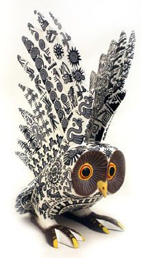 Gorgeous Zapotec Owl by Mario Castellanos.  This beautiful Pre-Columbian bird is wonderfully painted in gray and black and features Zapotec codex elements.  The wings are meticulously carved giving them texture and texture.