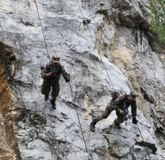 Two scouts rappel down a cliff during a field training exercise. A special operations element with a reconnaissance battalion attached to the PLA 41th Group Army conducted field training on rock-climbing and rappelling to refine the scouts' combat skills.