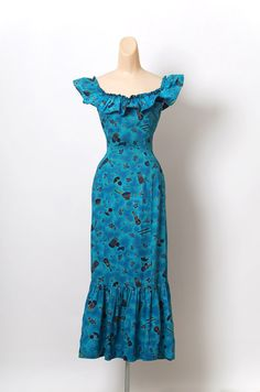 A personal favorite from my Etsy shop https://www.etsy.com/listing/188071058/vintage-50s-60s-hawaiian-dress-hola-muu