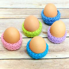 This Easter egg cozy crochet pattern is a super cute way to show off your Easter eggs. They work up so quickly that you can easily make a bunch. And since you only need a small amount of yarn per cozy, they make a great scrapbuster project too! #crochet #easter