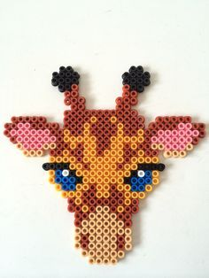 Giraffe hama perler beads by Louise Nielsen Más Easy Perler Bead Patterns, Melty Bead Patterns, Perler Bead Templates, Diy Perler Beads, Perler Bead Art, Beading Patterns, Melty Beads Ideas, Loom Patterns, Peyote Patterns