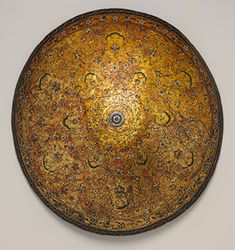 Parade shield, late 16th century  Venice  Wood, leather, iron, silver, varnish, and polychromy