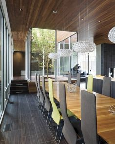 lovely!  floor, ceiling, lighting and oh yea that table is hot!  Curved House by Hufft Projects