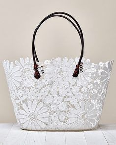 Coated Lace Tote Bag Coated floral crochet lace tote bag with scallop finish and vegan leather straps details. Tote Handbags, Purses And Handbags, Luxe Boutique, Lace Bag, Crochet Tote, Crochet Daisy, Diy Handbag, Patchwork Bags, Fabric Bags