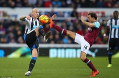 Shelvey (left) goes in for the ball with West Ham captain Mark Noble as both leaders do battle on the pitch on Saturday in Newcastle