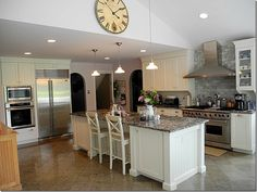 from Cote de Texas.  Love the stove and exhaust fan with tiled wall.  Feet for beadboard cabinet.  Lovely kitchen!!