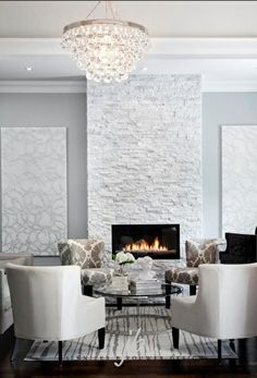 Floor to ceiling stone fireplace is to die for. Love the artwork as well.