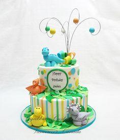Dinosaur themed Cake ... Buttercream with fondant details. www.facebook.com/Cynthias.Custom.Cakes