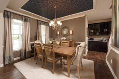 A dramatic ceiling defines the dining room of the Sycamore plan, a new home built by Timberlake Homes. The Reserve at Chestnut Ridge community. Magnolia, DE.