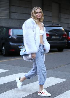 White fur 'over-sized jacket' = coat / Dior bra-let 'crop-top' +  baby-blue jeans. Chiara Ferragni during #FW17 #MFW #Style