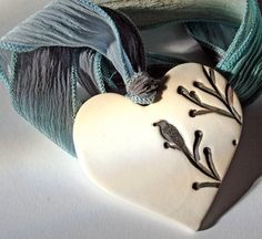 I'm not much of a romantic but I love this little bird on a heart from Lisa Peters...