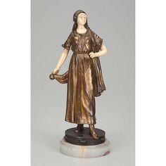 ALONZO, Dominique Dançarina espanhola. Escultura de bronze e marfim, sobre pandeiro de bronze. Base de ônix. Assinada. 25,5 cm de altura. França, c. 1930.