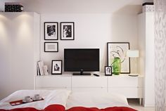 If you love watching TV in your bedroom, but don't love the look, hang art around the screen to make it look like part of a wall collage.