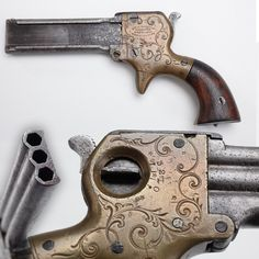 Marston Three Barrel Derringer - About 1,500 derringers in .22 caliber were produced by William W. Marston of New York City from 1858 to 1864. His design included two unusual features: a selector switch to choose which barrel to fire and also a sliding knife that mounted on the side of the barrels. While our example is missing the blade (anybody got a spare?), our selector still functions normally and is set up for barrel #2 at present. NRA National Firearms Museum in Fairfax, VA