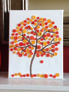 A canvas, paint, buttons, and glue are all you need for this fun fall craft! #DIY #fall