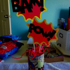 Superhero centerpieces...mod podge:) dressupmyparty