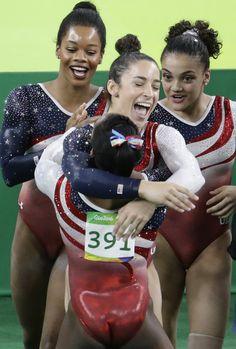 Gymnast Aly Raisman, center, hugs teammate Simone Biles as Gabby Douglas, back left, and Laurie Hernandez look on after winning the gold medal… Team Usa Gymnastics, Gymnastics Tricks, Gymnastics World, Gymnastics Posters, Gymnastics Pictures, Olympic Gymnastics, Artistic Gymnastics, Gymnastics History, Gymnastics Stuff