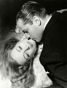 """Joan Crawford (1904-1977) and Alan Curtis (1909-1953) in """"Mannequin"""", 1937"""