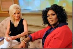 Michael Strahan femulates Oprah Winfrey on television's Live! With Kelly and Michael.
