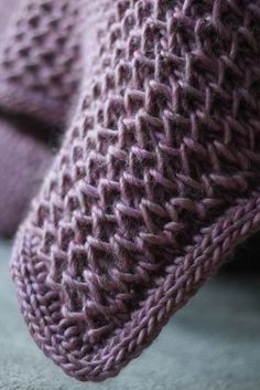 Free knitting pattern for Waffle Blanket - Ana Sancho Rumeu's squishy afghan has a 4-row, 3 stitch repeat. Once you learn it, it goes quickly. The border is an attached i-cord but if you can substitute a garter or seed stitch border if you want something simpler. Some knitters have used multi-color yarn which looks great in this stitch. This was designed as a regular sized afghan so you might customize the size when you knit.