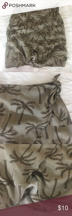 """Hawaiian cover up skirt / sarong 🌺Selling this item for my mama, feel free to bundle with anything in my closet🌺 ✨Newly listed items are priced to move.. please help me clear out my actual closet 😉 Brand: Casual Threads Clothing Co Size: S Type: cover up skirt / wrap around tie sarong Details: olive green Hawaiian print, thin lightweight fabric  Waist measurement (laying flat): 13.5"""" across Length: 20"""" Condition: preloved, good *some spots with thread unraveling ✨Build a bundle with all…"""