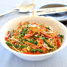 An incredible creamy peanut and sesame dressing with a hint of lime toss through a noodle and vegetable salad.
