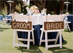 rustic wooden bride and groom signs
