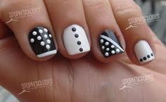 Love the idea of doing different designs on every nail in the same two colors