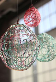 Hang these beautiful string balls to spruce up your office or a party. These cute round decor items are created from soaking string in glue then wrapping it around a balloon. Set to dry for a day.  Once it's dry, you just have to pop the balloon, and voilà! Source: Free People