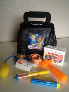 Fisher Price Doctor Kit. J - took the doctor kit to go help Grandpa because he wasn't feeling well - later became a nurse for real:)