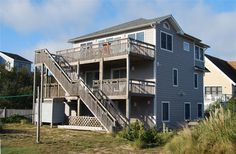 SANDY DUCK, #277 l Duck, NC - Outer Banks Vacation Rental Home l Oceanside home with six bedrooms, ocean and sound views, media area with wet bar, screened-in porch, private pool with option to heat, volleyball net, sheltered patio with built-in seating, picnic table under sheltered trellis and horseshoes. l www.CarolinaDesigns.com