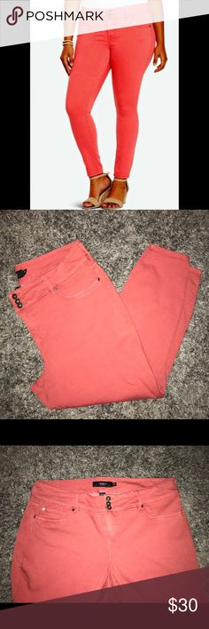 Torrid High Rose Stretchy Skinny Jeans The Torrid jeans are a coral/salmon color. They are considered skinny jeggings. They also have a triple button with fly zipper and belt loops. torrid Jeans Skinny