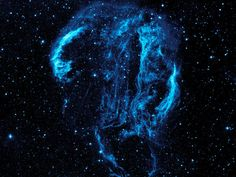 Cygnus Loop Nebula    Wispy tendrils of hot dust and gas glow brightly in this ultraviolet image of the Cygnus Loop nebula, taken by NASA's Galaxy Evolution Explorer. The nebula lies about 1,500 light-years away, and is a supernova remnant, left over from a massive stellar explosion that occurred between 5,000 to 8,000 years ago.
