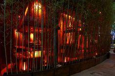 Ambiente: luz cálida, portada bambus.  Gallery of Kemuri Shanghai Restaurant / Prism Design - 8