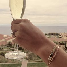 """Dreaming of Italy... Thank you @j_k_diamond for the most amazing photo from your honeymoon, wearing your new EFC nameplate bracelet (engraved with her wedding date in Roman Numerals). I love it layered with your diamond multi bezel bangle (her """"something new"""" from Mama). Congratulations Mr. and Mrs. Diamond! Xo, EF"""