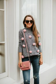 A beginner DIY project that anyone could make! This pom pom sweater is so fun for valentines day, or just a cozy winter day.