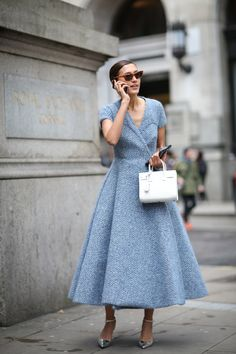 70 Style Lessons From The Streets Of London #refinery29 http://www.refinery29.com/2015/02/82710/london-fashion-week-2015-street-style#slide-21 El-e-gance! When wearing a dressier outfit during the day, pull your hair back in a low pony and find a boxier bag and fun shoes to play down the intensity.Emilia Wickstead dress.