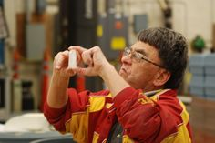 Mainstream Living Enclave Mark Kitchen, 56, inspects water reagents prior to packaging them at the Hach manufacturing facility in Ames on Wednesday. Photo by Grayson Schmidt/Ames Tribune http://www.amestrib.com/news/20161119/mainstream-living-enclave-program-still-strong-after-more-than-20-years
