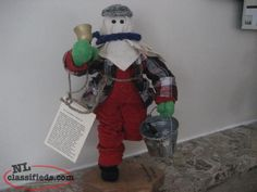 Look at the lovely Mummers... These are handmade and come with a card about mummering. Mummers hold various things...Ugly Sticks, Screech Bottles, Purity Syrup Bottles, Spoons, Fiddles, Washboards, Buckets, Accordions and Lanterns etc. This is a great gift for family members. These mummers can be picked up in St. John's at various times between now and December. Old Christmas, 12 Days Of Christmas, Outdoor Christmas, Christmas Ideas, Hobbies And Crafts, Arts And Crafts, Throw Pillow Cases, Throw Pillows, Newfoundland And Labrador