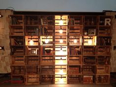 Beer crates into wall feature #shelves #lighting #cross