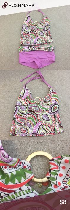 Paisley swimsuit Pink, white, green, and orange somewhat of a paisley printed tankini swimsuit. It has sort of a halter strap. The swimsuit has no padding or push up but it has a slot where you can add padding. I cut out the tag so I am not exactly sure on the size but it would best fit a medium. I have no idea where it is from so I just listed it as Forever 21. There is a gold ring in the middle with beads. The swimsuit has been worn and does look a little worn but doesn't really have any…