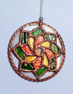 Rounded Pendant. Flower. Home decor. Rounded #Stained #Glass #Suncatcher, for window, wall. Handmade. Roomdecor. Home decor. DizArtEx.  Type: Stained Glass (Suncatcher,for win... #stainedglass #handmade #decor #homedecor #dizartex #housewares #flower #suncatcher #round #tiffany #stained #glass #door