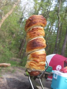 hot dog wrapped in pastry, cooked over fire camping