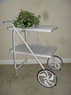 Hey, I found this really awesome Etsy listing at https://www.etsy.com/listing/179561451/vintage-mid-century-folding-wrought-iron