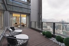 Stunning Penthouse In Hong Kong The penthouse is located on 68th floor of the Serenade complex completed in 2010 which consists of 270 units. In the living room the floor-to-ceiling windows open onto the large terrace offering magnificient city views.